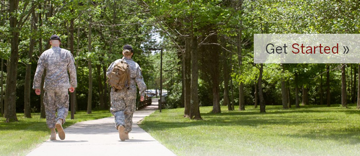 Military / Veteran Students walking on IU East Campus with caption, Get Started'