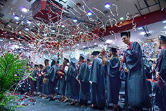 Graduates celebrate with confetti at commencement