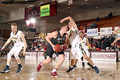 Red Wolves basketball take layup against opponent