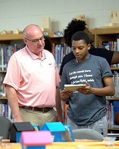 Tim Scales talks with a George Washington High School student