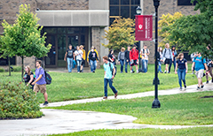 IU East students walk between Tom Raper Hall and the quad.