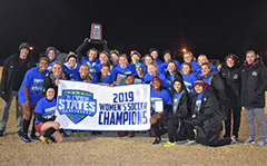 women's soccer team group photo with the River States Conference banner