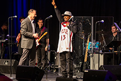 U Soul Revue director James A. Strong Jr. is presented with a Red Wolves jersey at the 2019 performance in the Student Events Center.