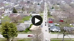 aeiral video shows cars traveling down street in Centerville