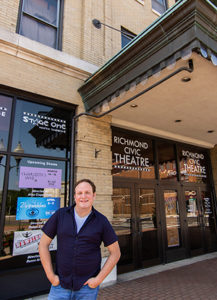 portrait of Ryan Shaw in front of theater