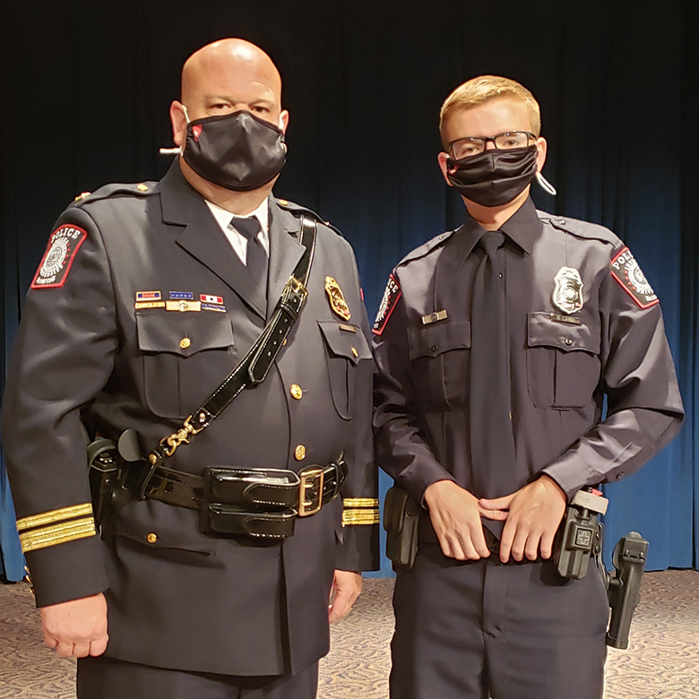 IUPD-East Chief Scott Dunning stands next to Cadet Dylin Lakes