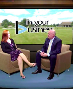 woman interviewed by a man for In Your Business
