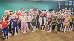 group photo of cardboard cutouts for People of the Pack
