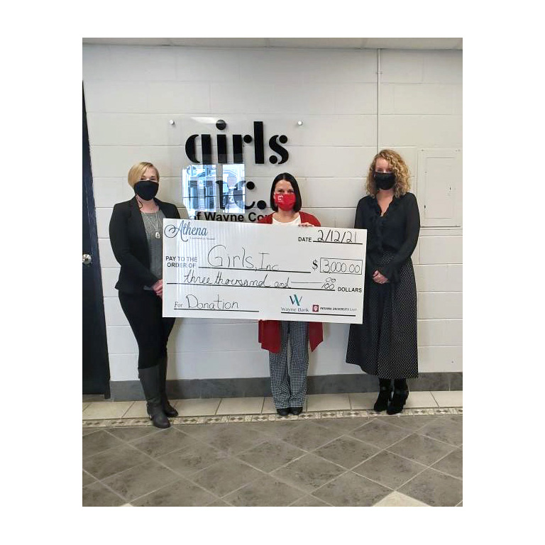 Wayne County ATHENA Leadership Awards present a donation to Girls, Inc. on behalf of sponsors Indiana University East and Wayne Bank. Girls, Inc. Executive Director Marcy Crull received the donation from (left) JoAnn Spurlock, vice president and director of operations at Wayne Bank, and (right) Paula Kay King, director of Gift Development at IU East.