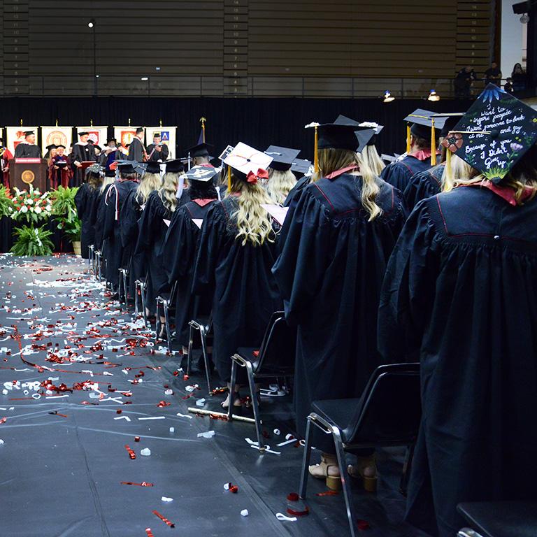 2019 graduates stand in the Richmond High School Tiernan Center