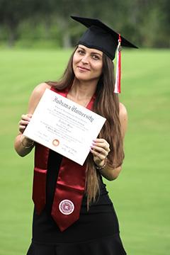 Teodora Mircic holds up her IU East diploma